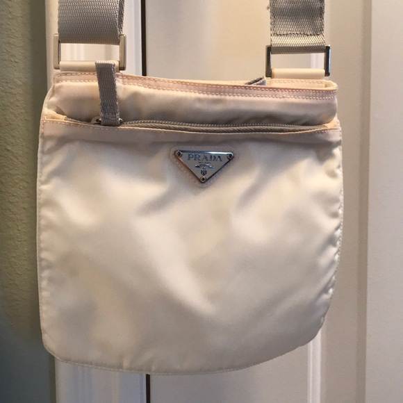 f518c548a584 Prada Nylon Crossbody Purse in off-white. M 5a7a4b25a4c485b2d181afbd. Other  Bags ...